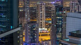 Dubai marina and JLT skyscrapers aerial skyline night timelapse. stock footage