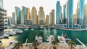 Dubai marina with modern buildings and traditional boat timelapse stock video