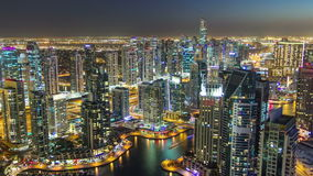Dubai Marina with modern towers from top of skyscraper transition from day to night timelapse stock footage