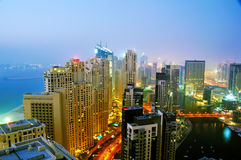 Dubai Marina Night Scene 3. Jumeirah Beach Residence towers and Marina buildings with the Palm in the background stock photography