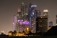 Dubai Marina By Night. Night view of Dubai Marina, notably Princess Tower, the tallest residential building, viewed from Jumeirah Beach Stock Photo