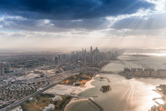 Dubai Marina and Palm Jumeirah against the sun Stock Photo