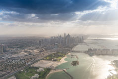 Dubai Marina and Palm Jumeirah against the sun Royalty Free Stock Photos