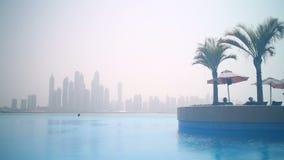Dubai marina panorama from swimming pool time lapse Stock Photo