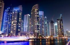 Dubai marina with skyscrapers and calm water night view Stock Photo