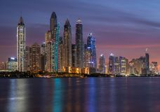Dubai Marina skyscrapers in the illuminations and their reflection in the water.  stock images