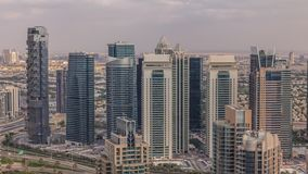 Dubai Marina skyscrapers and jumeirah lake towers view from the top aerial timelapse in the United Arab Emirates. Traffic on a road stock video footage
