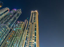 Dubai marina skyscrapers during night hours Stock Photo