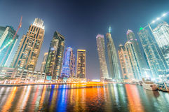 Dubai Marina skyscrapers reflections at night, UAE Stock Images
