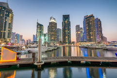 Dubai Marina skyscrapers reflections at night, UAE Stock Photo