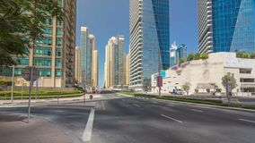 Dubai Marina with Skyscrapers timelapse hyperlapse and traffic on the street near concrete road bridge through the canal. Dubai Marina with Skyscrapers timelapse stock video footage