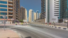 Dubai Marina with Skyscrapers timelapse hyperlapse and traffic on the street near concrete road bridge through the canal. Dubai Marina with Skyscrapers timelapse stock video