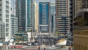 Dubai Marina with Skyscrapers timelapse and traffic on the street near concrete road bridge through the canal. Dubai Marina and JLT with Skyscrapers timelapse stock footage