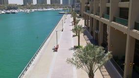 Dubai marina sunny day walking bay down view 4k uae. Uae dubai marina sunny day walking bay down view 4k stock video