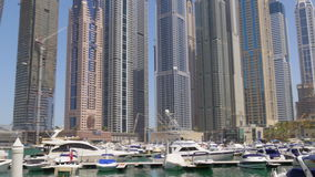 Dubai marina sunny day yacht dock buildings panorama 4k uae stock video