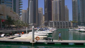 Dubai marina sunny day yacht dock pier 4k uae. Uae dubai marina sunny day yacht dock pier 4k stock video