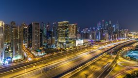Dubai marina with traffic on sheikh zayed road panorama day to night timelapse lights turn on. Dubai marina with traffic on sheikh zayed road panorama day to stock video footage