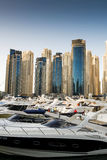 Dubai Marina, UAE. Boats and yachts parked in famous Marina district in Dubai, UAE Royalty Free Stock Images