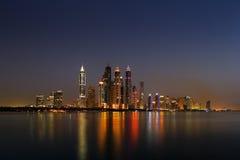 Dubai Marina, UAE at dusk as seen from Palm Jumeirah Stock Photo