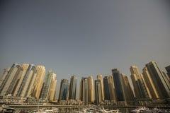 Dubai Marina. View at modern skyscrapers in Dubai Marina in Dubai, UAE. When the entire development is complete, it will accommodate more than 120,000 people Stock Photos