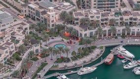 Dubai Marina Walk with fountain and palms aerial Top View night to day timelapse. Dubai Marina Walk with fountain and palms aerial Top View night to day stock video