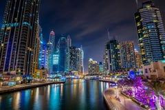 Dubai marina walk at night with illuminated buildings. United Arab Emirates royalty free stock image