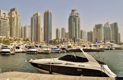 Dubai Marina Walk Yacht agressive design. Dubai Marina Walk Yacht black and white colors anchored Tourism Royalty Free Stock Image