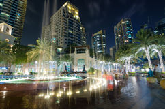Dubai marina water feature lights lit up at night with famous landmarkS Stock Images