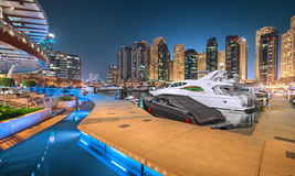 Dubai Marina Yacht Club in a magical blue night royalty free stock image