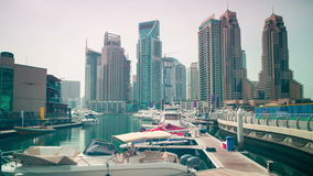 Dubai marina yacht dock 4k time lapse stock video footage