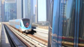 Dubai metro arriving to the station. Dubai metro journey on the modern Rail Metro System, arriving to the station stock video footage