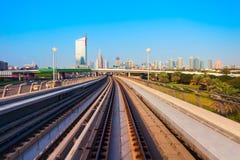 Dubai Metro and city skyline, UAE. Dubai Metro train and Dubai city skyline in UAE royalty free stock images