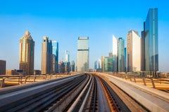 Dubai Metro and city skyline, UAE. Dubai Metro train track and Dubai city skyline in UAE stock photo