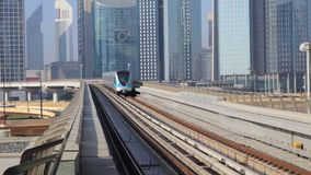 Dubai metro departure from the station stock video