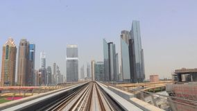 Dubai metro journey on the modern Rail Metro System, running alongside the city stock video
