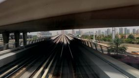 Dubai metro running alongside the city. Dubai metro journey on the modern Rail Metro System, running alongside the Sheikh Zayed Rd stock video