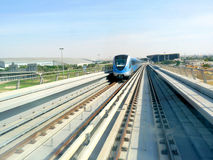 Dubai Metro Train. Approaching at an Intersection Stock Photo