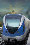 Dubai Metro Train. Arriving at the station. The image has burj al arab as background royalty free stock images