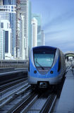 Dubai Metro Train. Arriving at the station. The image has burj al arab as background stock images
