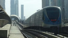 Dubai Metro Train. The Dubai Metro leaving a platform, it is world's longest driver less, fully automated metro network in the United Arab Emirates city of Dubai stock footage