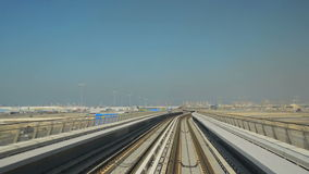 Dubai metro. Train in motion, view along line stock footage