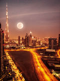 Dubai in moonlight. UAE, full moon, night scape in Dubai downtown, modern arabian architecture, middle east, illuminated city at night, luxury vacation stock image