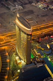 Dubai at night. View from the Burj Chalifa to another skyscraber Stock Images
