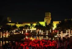Dubai at night. Restaurant at shopping center, reflected in lake Royalty Free Stock Images