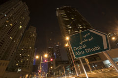 Dubai at Night. And Dubai Abu Dhabi bord stock image