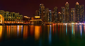 Dubai Night Reflection. A view of Dubai City skyscrapers from Dubai fountains royalty free stock photos