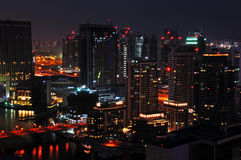 Dubai Night Scene 2. A landscape view of residential towers against Dubai Marina taken later in the night royalty free stock photo