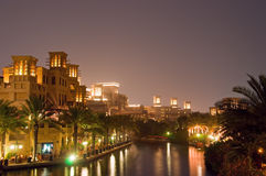 Dubai Night Scene 4. Madinat Jumeirah at night with illuminated buildings and reflections in the water royalty free stock photo