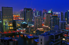 Dubai Night Scene. An evening landscape view of residential towers against Dubai Marina Stock Photo