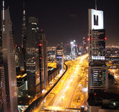 Dubai at night. UAE. Dubai financial and business district at night and metro station Stock Images